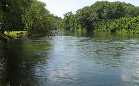TOCCOA RIVER ACCESS!!! Come Trout Fish and/or tube/canoe the beautiful waters of Toccoa River. Walk-into the waters from the access area of 100 Feet frontage or sit by rivers edge at the firepit. All this only approx. 7 miles from the shops and dining in Downtown Blue Ridge. (Photo of Toccoa River is from the access area not at lot)