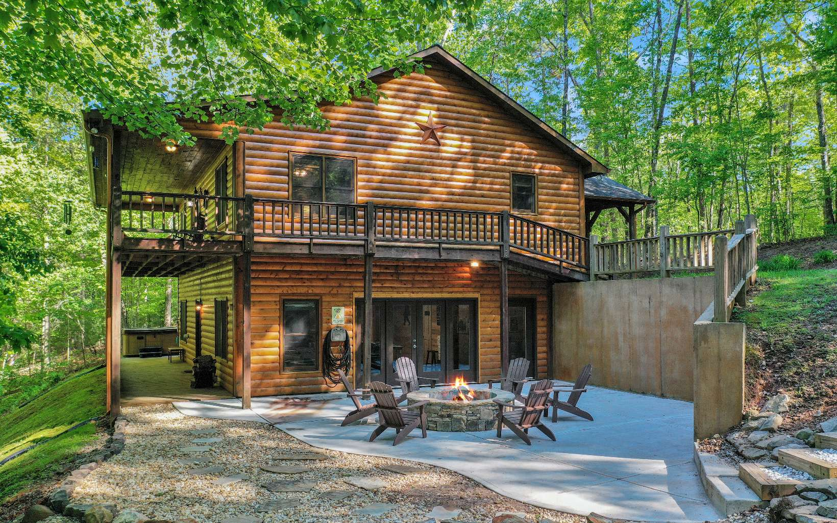 LOCATION & INVESTMENT OPPORTUNITY!! Hidden away in the North Ga mountains is this beautiful, fully furnished, 3 bed 3 bath cabin. This is a cabin that can provide years of enjoyment and relaxation. This cabin is located in the heart of adventure, being less than 2 miles away from public access to our beautiful Lake Blue Ridge, minutes away from Lake Blue Ridge Marina, historic downtown Blue Ridge, USFS hiking trails, and from the Toccoa River. Nestled in the cul-de-sac of a small subdivision named Lake Ridge, this cabin sits on approximately 3.41 acres of gentle laying wooded land. For those relaxing evenings, enjoy the game room, step outside to the hot tub, or maybe just roast some marshmallows over the newly added fire pit. A true place of tranquility and memories. Come get your piece of heaven!