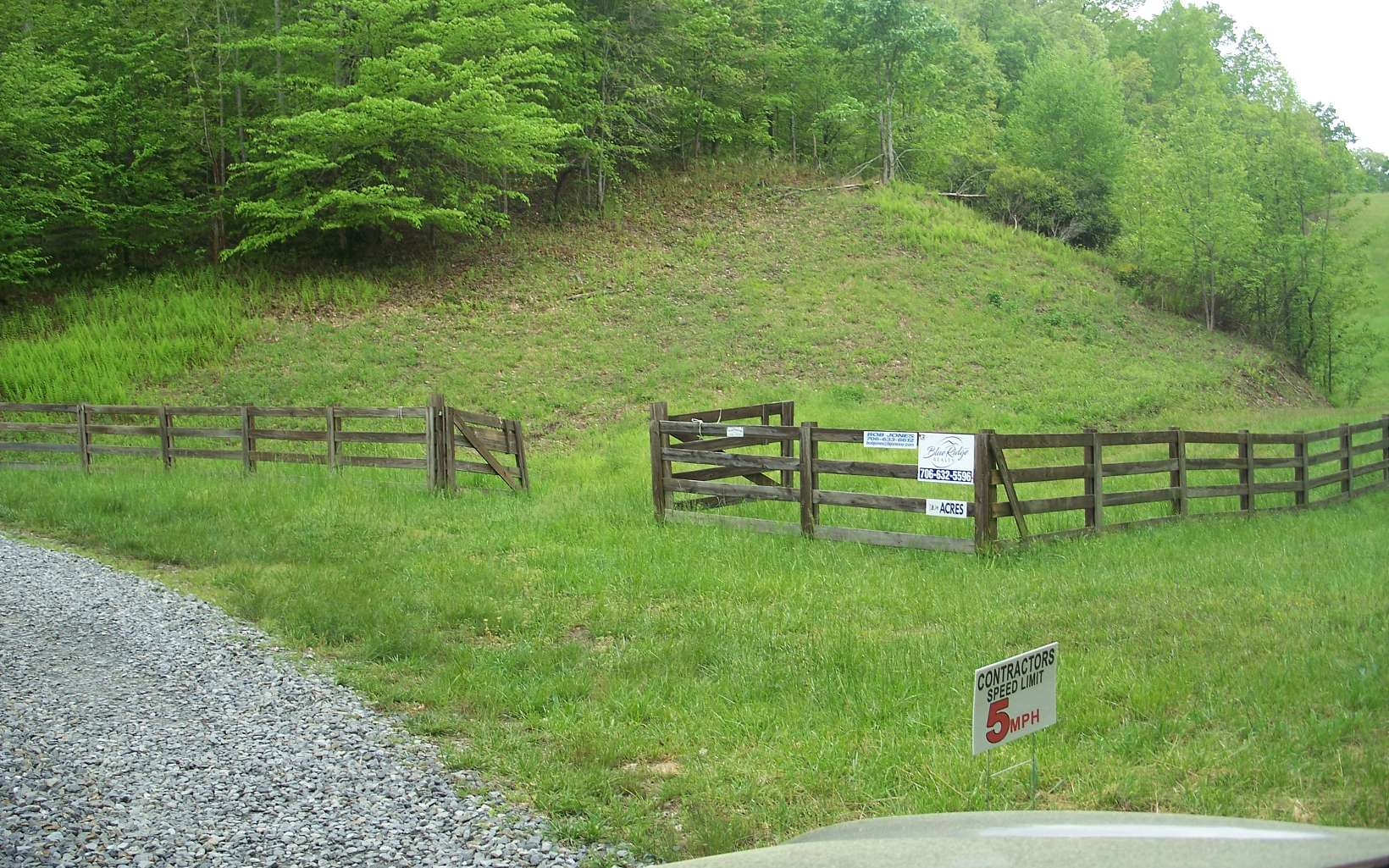 This 18.24 Acre tract has Mountain long range Views, Mature Timber, A Spring,,Fenced Pasture with Board Fence . Gated and Borders USFS and is within a 124 acre Ranch that is gated with common private Road that serves a total of 7 property owners, located 1/2 mile from hwy515 between Blue Ridge and Blairsville.