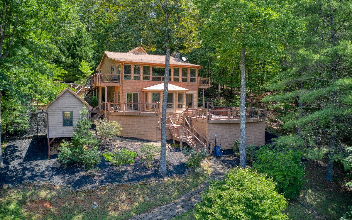 BLUE RIDGE LAKE + TOCCOA RIVER + MOUNTAIN VIEW, year round all rolled into one property. 2.44 Acres, During the Summer you can enjoy your time on the Lake at the Double Decker Dock, Winter time you have the sounds of the Toccoa River. You can enjoy the Mountain View of the National Forest Across the Lake anytime from the Home. This home has been remodeled with additions galore. Huge Deck Area (all Decking is Trex Composite) Hot Tub, Out Building with a Concrete Golf Cart path leading down to the Lake. You can also drive down to the lake. Fenced Terrace Garden Area. Bordering the National Forest makes this a Sweet Sweet Spot. 2 Sun Rooms, Pickled Pine, Walls of Windows, Deep Water & All paved access except approx. 300 FT. FURNISHED except for a few personal items. Price includes Additional 1.40 AC Buildable lot with Deeded Lake Access.