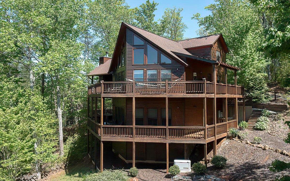 This Exceptional Prow Front 3BR/3BA Hand Hewn Log Sided Cabin, perched high above the rest w/stunning lofty Mtn views, offers 3 levels of Rustic Charm & is located in the Aska Adventure Area! Catch the ultimate Blue Ridge Mtn experience while hanging out on the 14X17 Fireplace porch w/stacked stoned F/P, terrace level hot tub porch or anywhere else on the 1700sf decks & porches. The Cabins Interior, full of Mtn character, features: 2 interior rock fireplaces, Cathedral ceiling in Greatroom, Wall of glass w/unlimited views, Granite & Custom log counter tops & cabinets; hammered copper sinks, Master suite w/double vanity & sep tile shower; Rec-room ready for entertaining w/pool table/wetbar; lge storage area w/water purification system & Generator.Exterior grounds offer a Fire Pit area surrounded by well appointed rocked land scaping. This all inclusive Mtn Retreat is in a successful Cabin Rental Program. All furnishings available for sale.