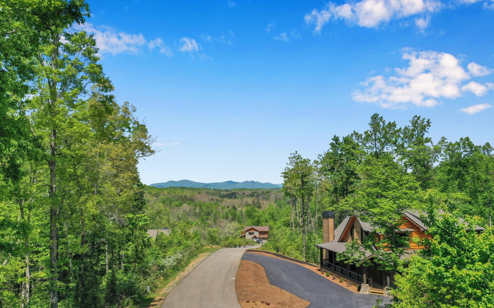 LONG RANGE MOUNTAIN VIEWS-PRESTIGIOUS STAUROLITE MOUNTAIN COMMUNITY. PREMIUM 2.39 ACRE LOT. Nice Level spot to build with specular YEAR ROUND BLUE RIDGE mountain views. This fully gated community is an upscale subdivision featuring paved roads with professional landscaping, waterfall, large party pavilion with rock fireplace alongside the small creek & stocked pond. You can't beat this location 5 minutes from downtown. -City Water-Easy Access 515