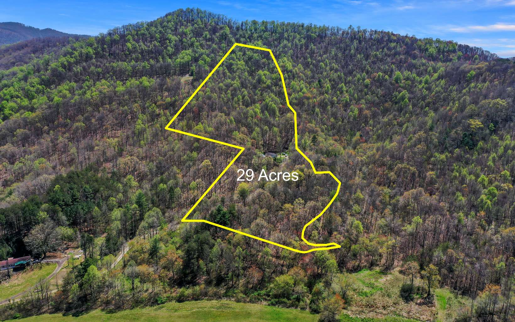 BEAUTIFUL 29 ACRE TRACT~UNRESTRICTED Nice ridge sites, spring, and a small creek. Very private and peaceful. Great Views!!! MOUNTAINTOP POND. Perfect for that private estate. Gravel road to the heart of the property. 32x48 Doublewide with electric and septic in place.Property does have its Mineral Rights.Easy Access to Ducktown,TN, Murphy NC & McCaysville, GA