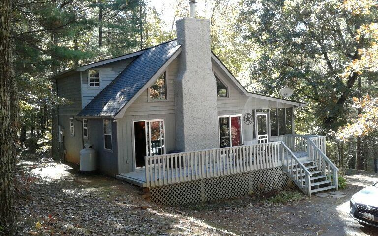 Centrally Located Between Blue Ridge Lake and Nottely Lake. Furnished 2 bedroom 2 full bath, Laundry on Main, Newer vinyl windows and 2 Sliding doors, Vented Fireplace with Gas Logs. Nice Appliances, spacious cabinets, Screen porch and open Deck with Hot Tub for Fun! Easy Access from Hwy 515, approx. 10 minutes from Downtown Blue Ridge for Dining and Shopping.